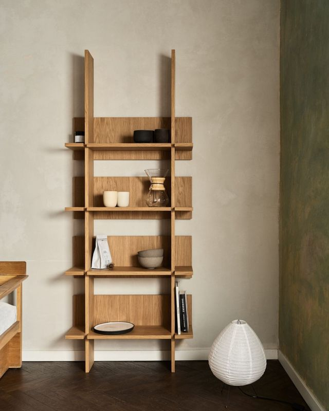 The geometric lines of the shelving unit enhance the clarity of your kitchen, making the proportions of your space more sound.   Discover the Norwegian Wood Shelving Concept at fropt.com. Link in bio.